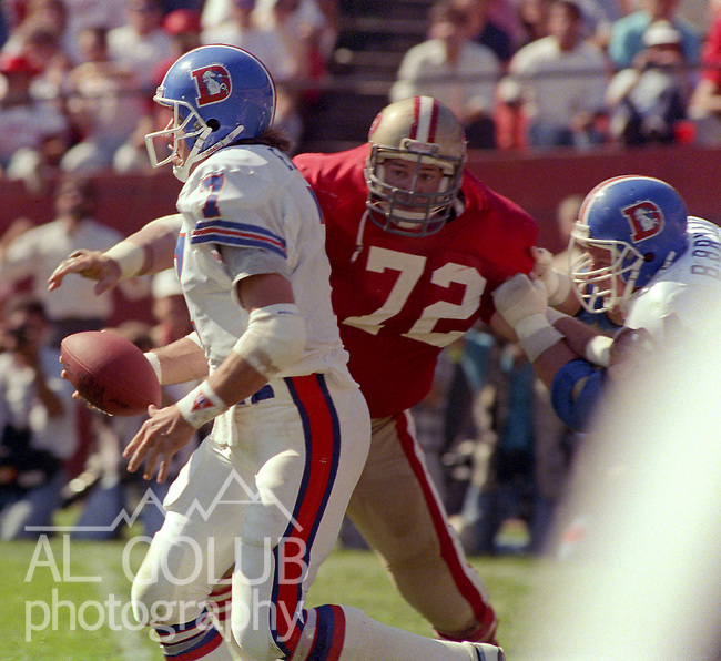 San Francisco 49ers vs Denver Broncos at Candlestick Park Sunday, October 9, 1988..Broncos beat 49ers 16-13.San Francisco defensive end Jeff Stover (72) puts pressure on Denver Bronco quarterback John Elway (7)..