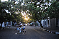 A lady rides a bycycle with her son near Aurobindo Asram. Bycycle is a very popular coviance in the French colony in Pondicherry. Arindam Mukherjee