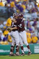 Texas A&M Aggies catcher Michael Barash (5) hugs teammate Andrew Vinson (10) at the end of Southeastern Conference baseball game against the LSU Tigers on April 25, 2015 at Alex Box Stadium in Baton Rouge, Louisiana. Texas A&M defeated LSU 6-2. (Andrew Woolley/Four Seam Images)