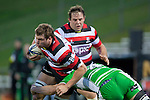 Ronald Raaymakers gets tackled by Michael Fitzgerald. ITM Cup rugby game between Counties Manukau and Manawatu played at Bayer Growers Stadium on Saturday August 21st 2010..Counties Manukau won 35 - 14 after leading 14 - 7 at halftime.