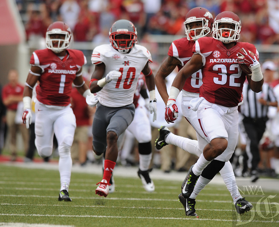 NWA Media/ANDY SHUPE - Arkansas running back Jonathan Williams (32) heads to the end zone for a 90-yard touchdown run through the Nicholls defense during the second quarter Saturday, Sept. 6, 2014, at Razorback Stadium in Fayetteville