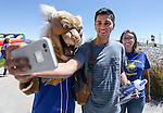 Pablo Cruz poses with Willy and Diana Gurrola during a student BBQ and club fair at Western Nevada College in Carson City, Nev., on Thursday, Sept. 1, 2016. <br />Photo by Cathleen Allison