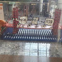 Little train crosses over a bridge in Canstruction in Brookfield Place in New York on Friday, November 6, 2015. (© Frances M. Roberts)