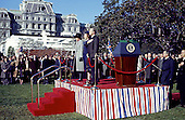 "Washington, DC - (FILE) -- United States President Jimmy Carter, right, Prime Minister Margaret Thatcher of the United Kingdom, center, and first lady Roslyn Carter, left, show respect for the presentation of the colors at the arrival ceremonies in Thatcher's honor at the White House in Washington, D.C. on Monday,December 17, 1979. In her remarks she praised 's, right, handling of the Iran hostage crisis by saying he has gained respect around the world for his courage and patience.  First lady Roslyn Carter, center, looks on..Credit: Benjamin E. ""Gene"" Forte - CNP"