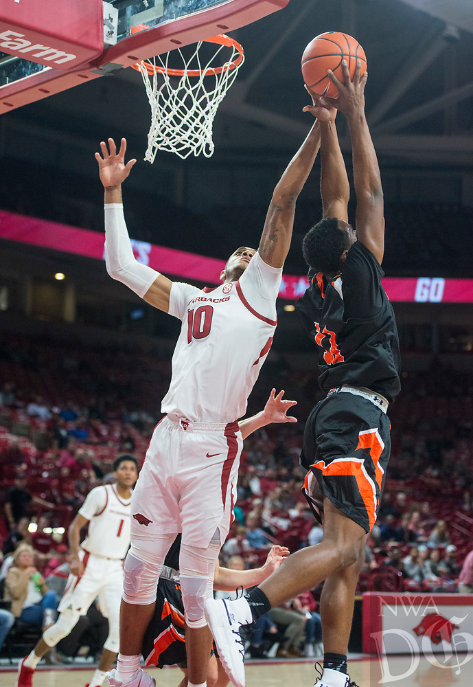 NWA Democrat-Gazette/BEN GOFF @NWABENGOFF <br /> Daniel Gafford (10) of Arkansas jumps for a rebound in the second half vs Tusculum Friday, Oct. 26, 2018, during an exhibition game in Bud Walton Arena in Fayetteville.