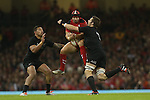 Wales fullback Leigh Halfpenny takes the high ball under pressure from All Blacks captain Richie McCaw and wing Charles Piutau.<br /> Dove men Series 2014<br /> Wales v New Zealand<br /> 22.11.14<br /> &copy;Steve Pope -SPORTINGWALES