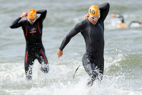 13 JUL 2013 - DEN HAAG, NED - Nicolas Tauty (FRA) (right) of France heads for transition at the end of the swim during the 2013 ITU Elite Men's Cross Triathlon World Championships  in Kijkduin, Den Haag (The Hague), the Netherlands (PHOTO COPYRIGHT © 2013 NIGEL FARROW, ALL RIGHTS RESERVED)