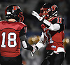 Joe Yarusso #11 of Plainedge, right, shakes hands with Brendan Godfrey #18 as he takes his place  in the fourth quarter of the Nassau County football Conference III semifinals against Lynbrook at Shuart Stadium in Hempstead on Saturday, Nov. 10, 2018. Yarusso had a catch for a 20-yard touchdown and made three interceptions, including one he returned 97 yards for another touchdown in Plainedge's 34-7 win.