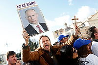 A supporter with a photo of Putin<br /> Rome December 8th 2018. Rally of Lega Nord Party 'Italians first' in Piazza del Popolo.<br /> Foto Insidefoto