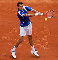 Marin Cilic (CRO) (10) against Robin Soderling (SWE) (5) in the third round of the men's singles. Robin Soderling beat Marin Cilic 6-4 6-4 6-2 ..Tennis - French Open - Day 8 - Sun 30 May 2010 - Roland Garros - Paris - France..© FREY - AMN Images, 1st Floor, Barry House, 20-22 Worple Road, London. SW19 4DH - Tel: +44 (0) 208 947 0117 - contact@advantagemedianet.com - www.photoshelter.com/c/amnimages