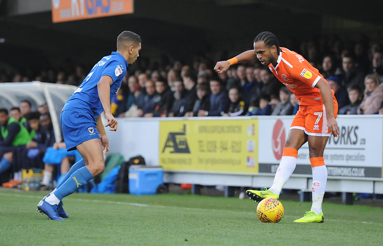 Blackpool's Nathan Delfouneso under pressure from AFC Wimbledon's Tennai Watson<br /> <br /> Photographer Kevin Barnes/CameraSport<br /> <br /> The EFL Sky Bet League One - AFC Wimbledon v Blackpool - Saturday 29th December 2018 - Kingsmeadow Stadium - London<br /> <br /> World Copyright © 2018 CameraSport. All rights reserved. 43 Linden Ave. Countesthorpe. Leicester. England. LE8 5PG - Tel: +44 (0) 116 277 4147 - admin@camerasport.com - www.camerasport.com