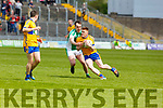 St Senans Seam Weir under pressure from Andrew Barry   in the Junior Premier football championship final on Sunday.