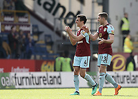 Burnley's Jack Cork and Stephen Ward applaud the fans at the final whistle<br /> <br /> Photographer Rich Linley/CameraSport<br /> <br /> The Premier League - Burnley v Leicester City - Saturday 14th April 2018 - Turf Moor - Burnley<br /> <br /> World Copyright &copy; 2018 CameraSport. All rights reserved. 43 Linden Ave. Countesthorpe. Leicester. England. LE8 5PG - Tel: +44 (0) 116 277 4147 - admin@camerasport.com - www.camerasport.com