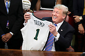 United States President Donald J. Trump holds uo a jersey as he welcomes the 2019 NCAA Division I Women's Basketball National Champions, the Baylor Lady Bears, in the Oval Office of the White House on April 29, 2019 in Washington, DC. <br /> Credit: Oliver Contreras / Pool via CNP