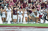 MSU quarterback Nick Fitzgerald runs past a University of South Carolina defender in the first quarter of Saturday's game at Davis Wade Stadium. The Bulldogs went on to win 27-14, giving MSU a 1-0 start in Southeastern Conference competition. <br />
