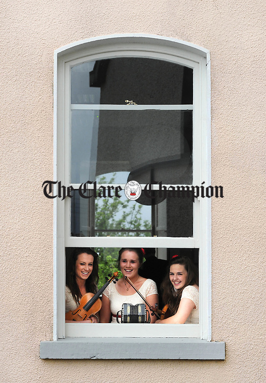 Sorcha Costello, Eimear Donnellan and Amy Mc Namara behind the scenes during the official opening of An Cnoc Na Gaoithe Comhaltas Cultural Centre in Tulla. Photograph by Declan Monaghan
