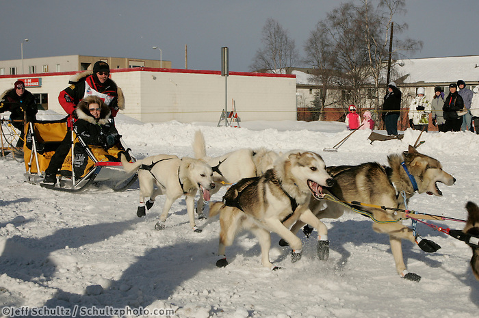 Mitch Seavey rounds the Cordova St. turn in Anchorage on Saturday March 1st during the ceremonial start day of the 2008 Iidtarod Sled Dog Race.