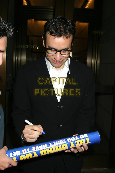 "FRED ARMISEN.""Anchorman The Legend of Ron Burgundy""- New York Premiere - Outside Arrivals, The Museum of Television & Radio.New York City, New York .July 7, 2004 .half length, black rimmed glasses, signing autograph.www.capitalpictures.com.sales@capitalpictures.com.©Capital Pictures"