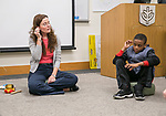 Dr. Martha Mason, director of  DePaul's Education and Counseling Center at the College of Education, and student Dylan Fulbright, right, carefully squeeze a fruit snack to hear if it makes any noise during a meditation class Thursday, April 27, 2017, to introduce them to mindfulness practices such as breathing and observation. (PHOTO RELEASES ON ALL CHILDREN WERE SECURED) (DePaul University/Jamie Moncrief)