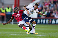 Tendayi Darikwa of Nottingham Forest tackles Lee Gregory of Millwall during the Sky Bet Championship match between Nottingham Forest and Millwall at the City Ground, Nottingham, England on 4 August 2017. Photo by James Williamson / PRiME Media Images.