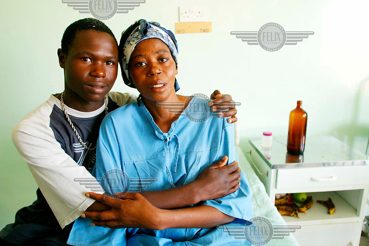 HIV positive patient in hospital with her son.