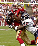 San Francisco 49ers wide receiver Terrell Owens (81) makes catch as Chicago Bears defensive back Michael Green (43) tackles him on Sunday, September 7, 2003, in San Francisco, California. The 49ers defeated the Bears 47-7.