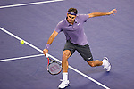 SHANGHAI, CHINA - OCTOBER 15:  Roger Federer of Switzerland returns a ball to Robin Soderling of Sweden during day five of the 2010 Shanghai Rolex Masters at the Shanghai Qi Zhong Tennis Center on October 15, 2010 in Shanghai, China.  (Photo by Victor Fraile/The Power of Sport Images) *** Local Caption *** Roger Federer