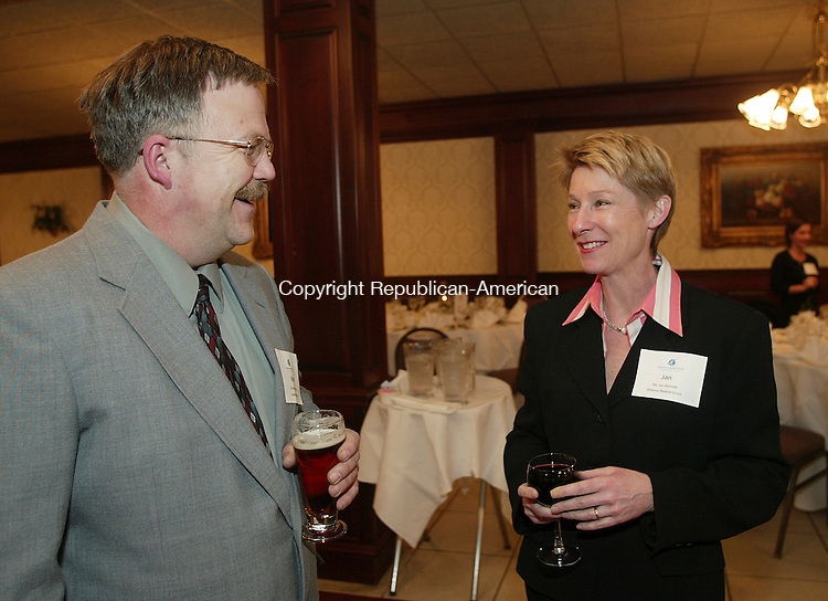 SOUTHINGTON, CT - 01 March 2005 -030105BZ09-  From left- Brian Emerick, Executive Director at Access Rehab Center; and Jan Kennedy, Executive Director at Alliance Medical Group<br /> <br /> talk during the State of the State Legislative dinner at the Aqua Turf in Southington Tuesday night.  <br /> Jamison C. Bazinet Photo