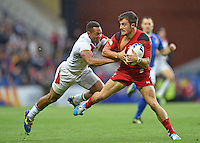 Wales's Luke Morgan evades the tackle of England's Daniel Norton<br /> <br /> Wales Vs England - men's classification 5th - 6th place match<br /> <br /> Photographer Chris Vaughan/CameraSport<br /> <br /> 20th Commonwealth Games - Day 4 - Sunday 27th July 2014 - Rugby Sevens - Ibrox Stadium - Glasgow - UK<br /> <br /> © CameraSport - 43 Linden Ave. Countesthorpe. Leicester. England. LE8 5PG - Tel: +44 (0) 116 277 4147 - admin@camerasport.com - www.camerasport.com