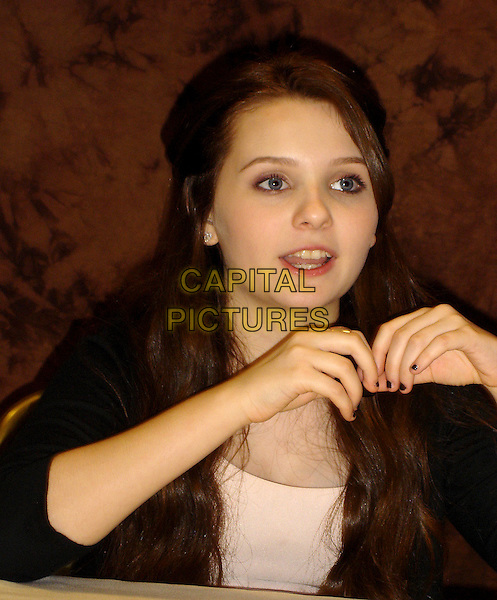 "ABIGAIL BRESLIN.Press conference for ""My Sister's Keeper"" at Casa Del Mar, Santa Monica, California, USA..June 7th, 2009.half length nail varnish polish mouth open hands black.CAP/AW.©Anita Weber/Capital Pictures."
