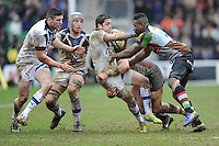 Horacio Agulla of Bath Rugby is tackled by Ugo Monye of Harlequins during the Aviva Premiership match between Harlequins and Bath Rugby at the Twickenham Stoop on Saturday 13th April 2013 (Photo by Rob Munro)