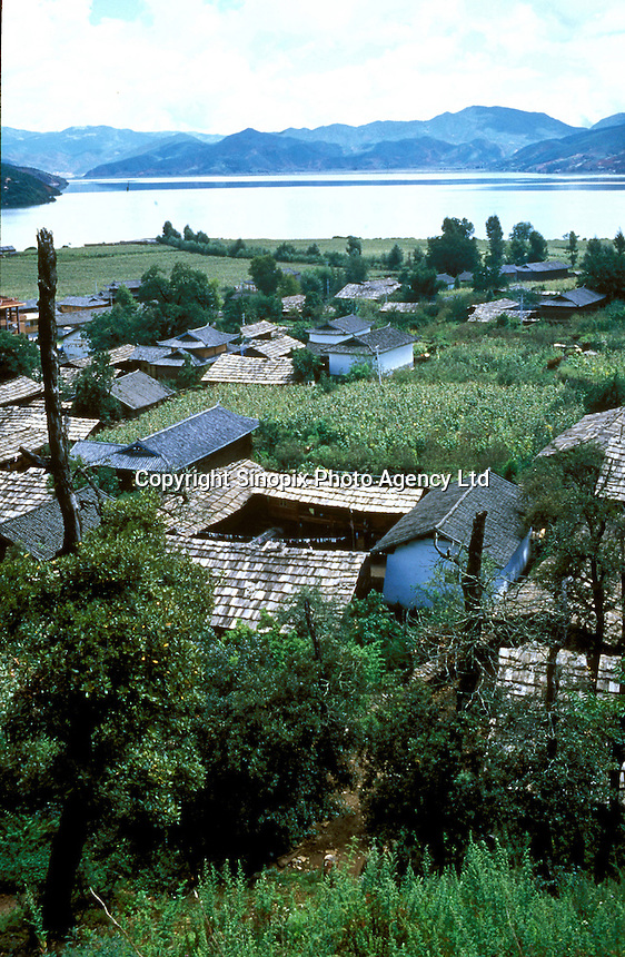 "A Mosuo village on the banks of Lugu lake in Yunnan. Lugu lake is said to have been formed by the footprint of a fleeing god. Women from the Mosuo tribe do not marry, take as many lovers as they wish and have no word for ""father"" or ""husband"". But the arrival of tourism and the sex industry is changing their culture...PHOTO BY SINOPIX"