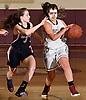 Jessica Scuderi #21 of North Shore, right, looks to get inside the paint as Katherine Buonfiglio #3 of Cold Spring Harbor guards her during the Nassau County varsity girls basketball Class A quarterfinals at North Shore High School in Glen Head, NY on Wednesday, Feb. 22, 2017. North Shore won by a score of 74-46.