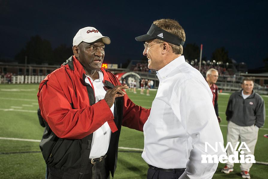 NWA Democrat-Gazette/ANTHONY REYES &bull; @NWATONYR<br /> Gus Malzahn (right) former head coach for the Springdale High School football team, talks with a Fort Smith Northside coach Friday, Oct. 23, 2015 at Jarrell Williams Bulldog Stadium in Springdale.