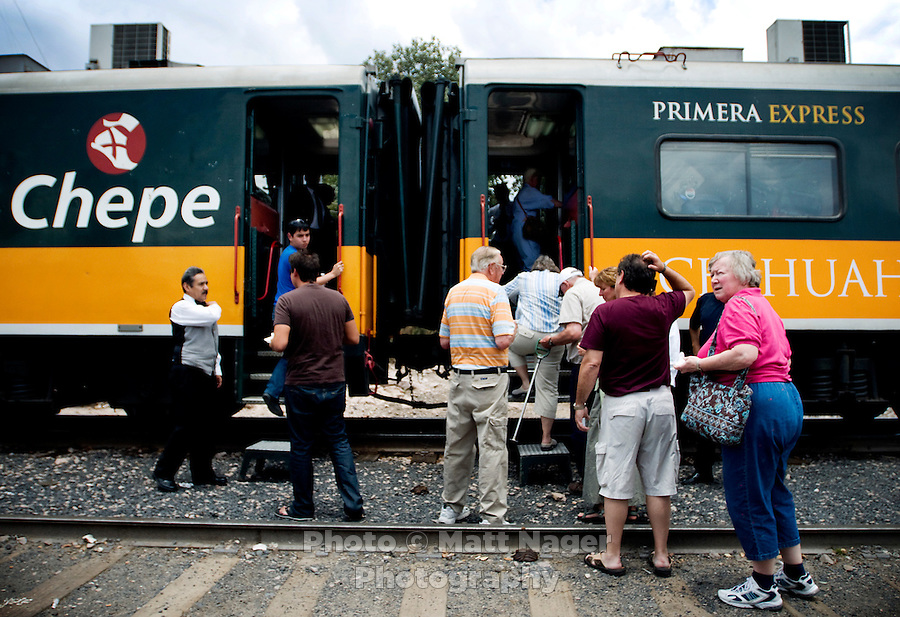 A crowd rushes to board the Express train at the Divisadero train stop in Copper Canyon, Mexico, Friday, June 20, 2008. There are two classes of train riding the Chihuahua Pacific Railway, Economic and First Express...PHOTOS/ MATT NAGER
