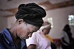 Women pray in a United Methodist church in Kananga, DR Congo.