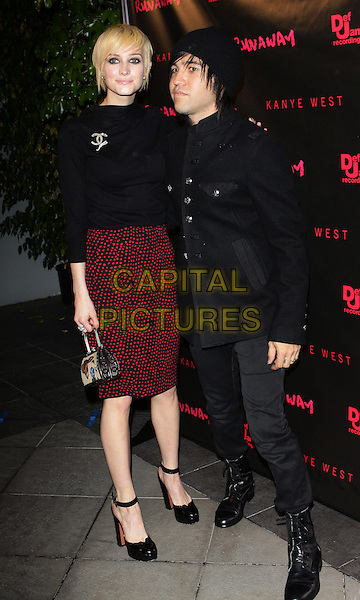"ASHLEE SIMPSON & PETE WENTZ.Los Angeles Premiere of ""Runaway"" held at Harmony Gold Preview House, Los Angeles, California, USA..October 18th, 2010.full length black jacket jeans denim boots top red maroon skirt chanel brooch shoes ankle straps married hat husband wife short cropped hair .CAP/ADM/TC.©T. Conrad/AdMedia/Capital Pictures."