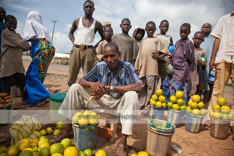 A Fulani man sells oranges at a roadside market in Nigeria's Niger State.