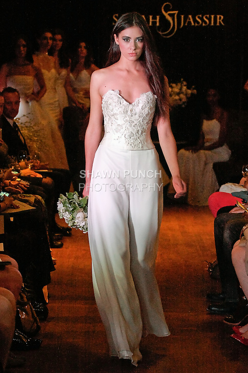 Model walks the runway in a Jolie wedding outfit - (2 piece ensemle) re-embroidered beaded bustier with silk chiffon pants, by Sarah Jassir, for the Sarah Jassir Couture Bridal Fall 2012 Opulence collection.