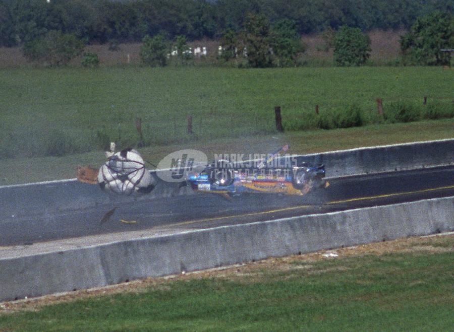 Oct. 26, 1997; Baytown, TX, USA; NHRA competition eliminator driver Robert Freeman crashes during the Matco Tools Supernationals at Houston Raceway Park. Mandatory Credit: Mark J. Rebilas-