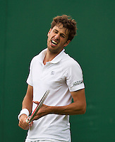 24-06-13, England, London,  AELTC, Wimbledon, Tennis, Wimbledon 2013, Day one, Robin Haase (NED) is frustrated<br /> <br /> <br /> <br /> Photo: Henk Koster