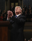 WASHINGTON, DC - JANUARY 30:  U.S. President Donald J. Trump claps during the State of the Union address in the chamber of the U.S. House of Representatives January 30, 2018 in Washington, DC. This is the first State of the Union address given by U.S. President Donald Trump and his second joint-session address to Congress. <br /> Credit: Win McNamee / Pool via CNP