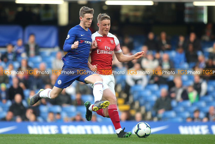 Danny Ballard of Arsenal and Chelsea's Charlie Brown challenge for the ball during Chelsea Under-23 vs Arsenal Under-23, Premier League 2 Football at Stamford Bridge on 15th April 2019