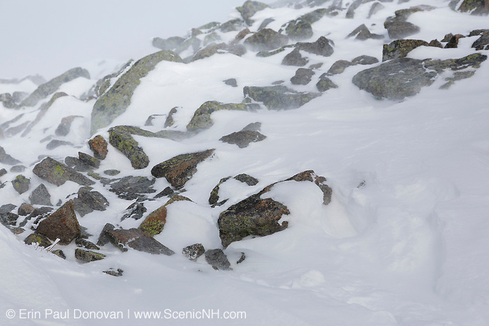 Strong winds blow snow across the open ridge of Mount Lafayette along the Greenleaf Trail in the White Mountains, New Hampshire during the winter months.