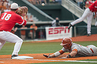 Texas Longhorns second baseman Brooks Marlow (8) dives back to first base as Houston Cougars first baseman Casey Grayson (18) catches the pick off throw during the NCAA baseball game on June 6, 2014 at UFCU Disch–Falk Field in Austin, Texas. The Longhorns defeated the Cougars 4-2 in Game 1 of the NCAA Super Regional. (Andrew Woolley/Four Seam Images)