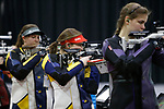 COLUMBUS, OH - MARCH 11:  Morgan Phillips of West Virginia University, center, competes during the Division I Rifle Championships held at The French Field House on the Ohio State University campus on March 11, 2017 in Columbus, Ohio. Phillips finished second in the individual championship with a score of 207.2. (Photo by Jay LaPrete/NCAA Photos via Getty Images)