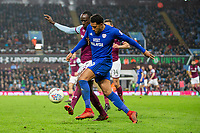 Albert Adomah of Aston Villa and Nathaniel Mendez-Laing of Cardiff City during the Sky Bet Championship match between Aston Villa and Cardiff City at Villa Park, Birmingham, England on 10 April 2018. Photo by Mark  Hawkins / PRiME Media Images.