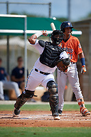 GCL Marlins catcher Luis Arcaya (8) throws to first base during a Gulf Coast League game against the GCL Astros on August 8, 2019 at the Roger Dean Chevrolet Stadium Complex in Jupiter, Florida.  GCL Astros defeated GCL Marlins 4-2.  (Mike Janes/Four Seam Images)