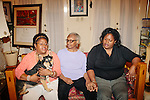 Lisa McNair (left to right) sits with her dog Banjo next to her mother Maxine and sister Kimberly Brock in her Birmingham, Alabama home August 13, 2013. Lisa's sister Denise McNair was the youngest victim who died in a bomb blast at 16th Street Baptist Church September 15, 1963.