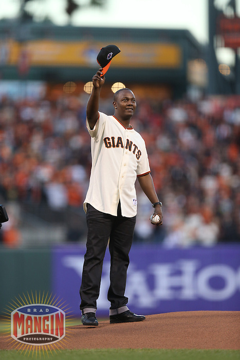 SAN FRANCISCO - OCTOBER 7:  Edgar Renteria, formerly of the San Francisco Giants throws out the first pitch before Game 2 of the NLDS against the Cincinnati Reds at AT&T Park on October 7, 2012 in San Francisco, California. (Photo by Brad Mangin)
